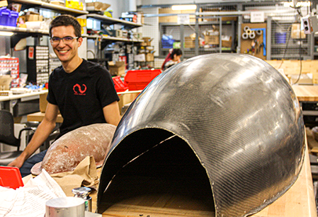 Alec Wyatt with the Cornell Hyperloop pod shell