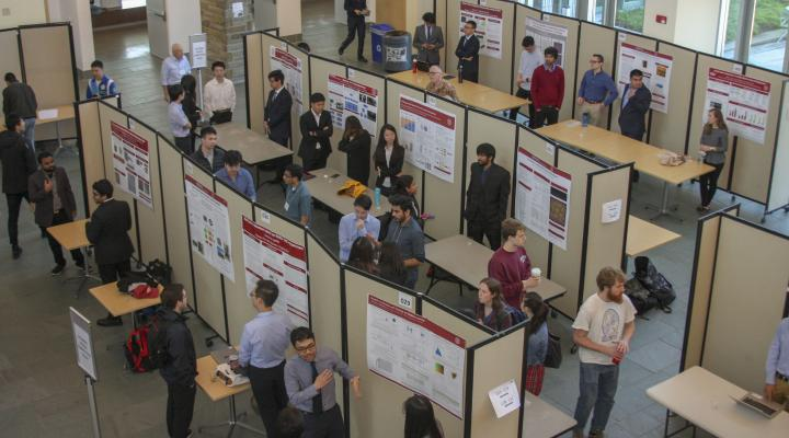 M.Eng. poster session participants display their posters in Duffield Hall