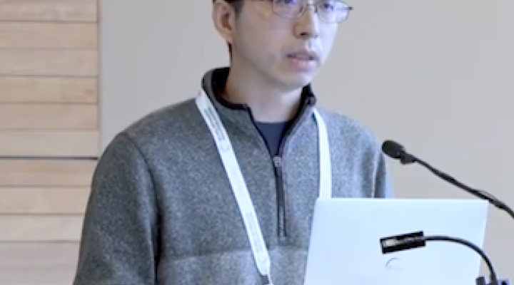 Zhiru Zhang gives a conference talk
