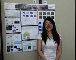Xiaochan Zong stands in front of her poster